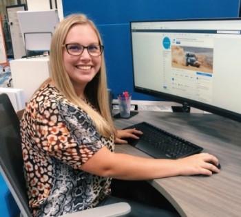 Optimized-Caroline at desk cropped